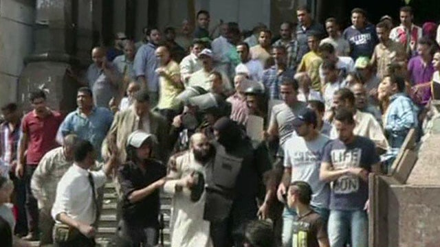 Reports of gunfire, explosions outside Egypt mosque