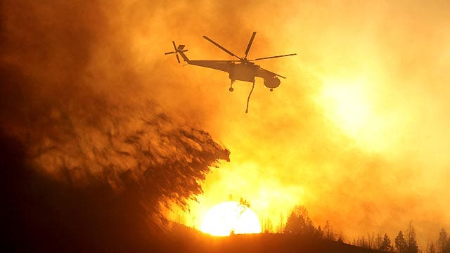 Firefighters battle to contain western wildfires