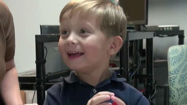 Boy hears mom's voice clearly for the first time
