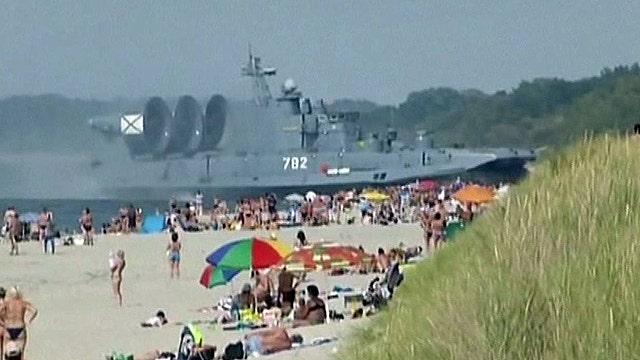 Massive military hovercraft surprises sunbathers in Russia