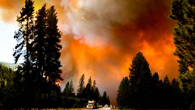 Dozens of Western wildfires burn out of control
