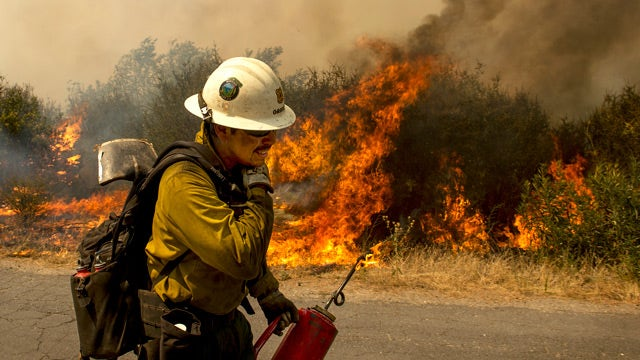 Wildfires rage across the West