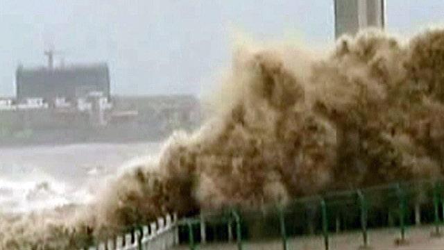 Massive tidal wave slams coastline in China