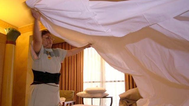 Single men struggle to change the bed sheets