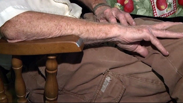 Two men rob veteran while duct-taped to chair