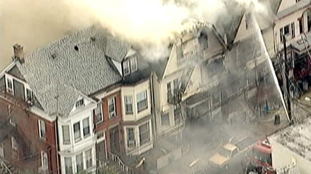 Fire rages through row of homes in New Jersey