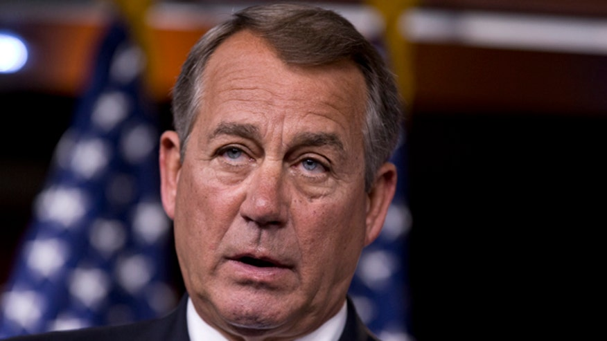 Activists rally outside Boehner's office