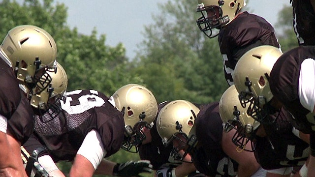 What kind of brain injuries do football players experience?