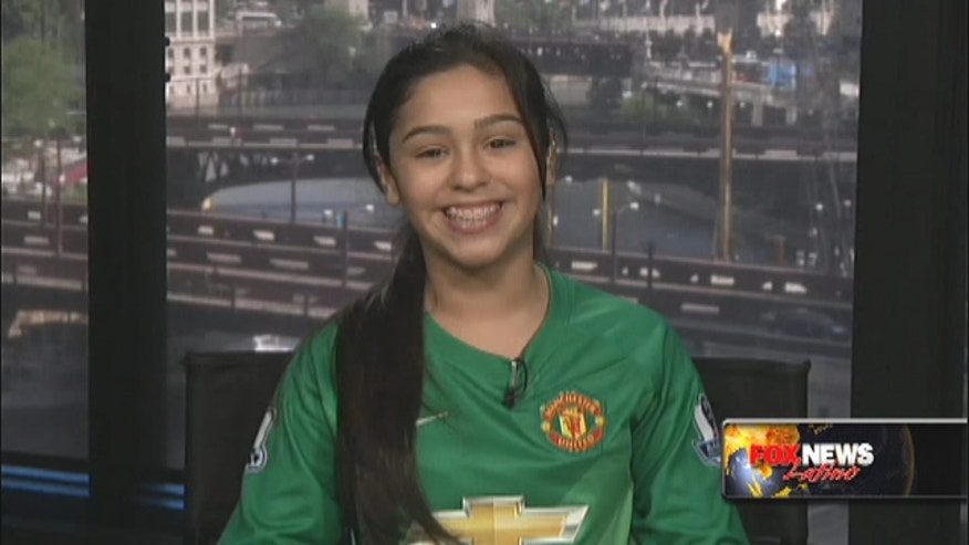 Jasmine Padilla, 11, got to walk out onto the field at Old Trafford Stadium accompanying a Man United player thanks to a Chevrolet promotion.