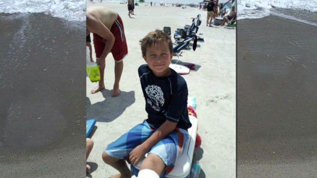 Little boy shakes off shark bite