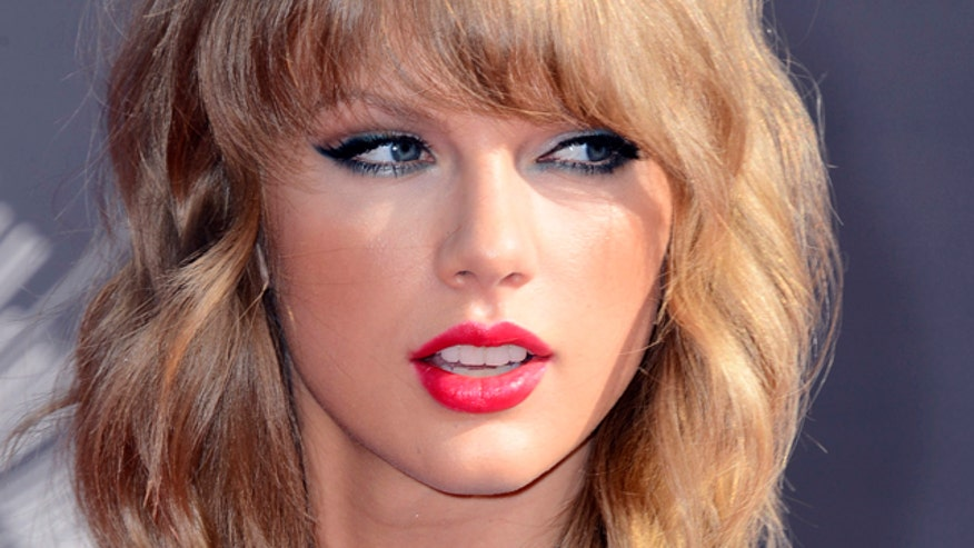 Four4Four: Swift gets sexy for Rolling Stone, calls out Katy Perry in new single. Oh, and Justin Bieber strips.
