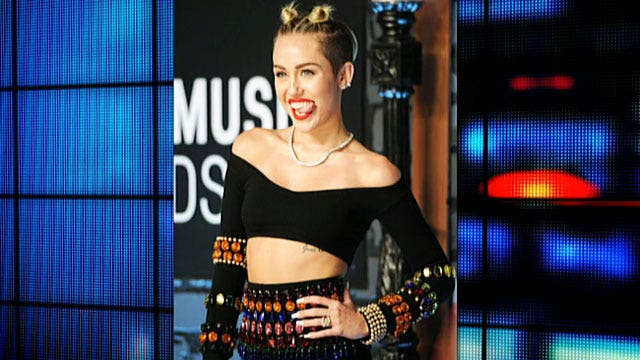 Miley Cyrus debuts artwork - featuring sex toys