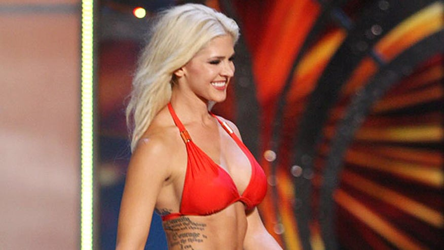 Beauty queen's tattoos revealed during swimsuit competition