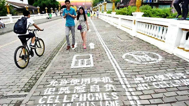 Grapevine: Chinese town has instated cellphone walking lanes