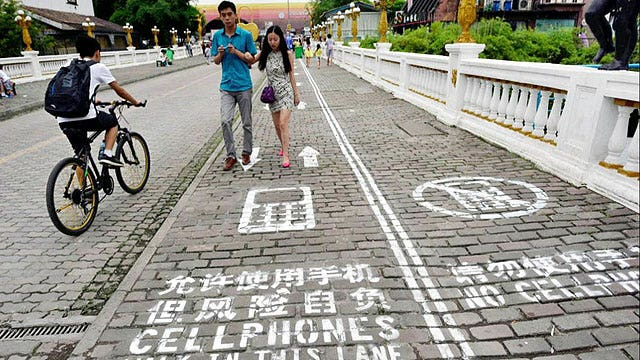 Chinese city creates sidewalk lane for people on phones