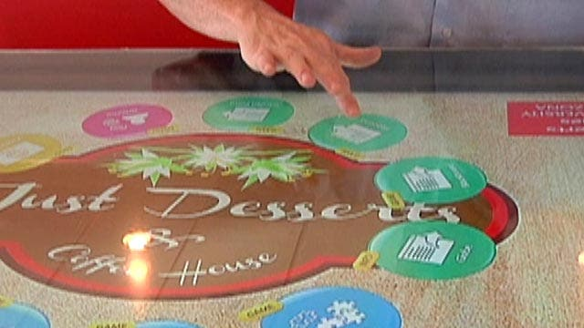 Smart tables combine entertainment and service