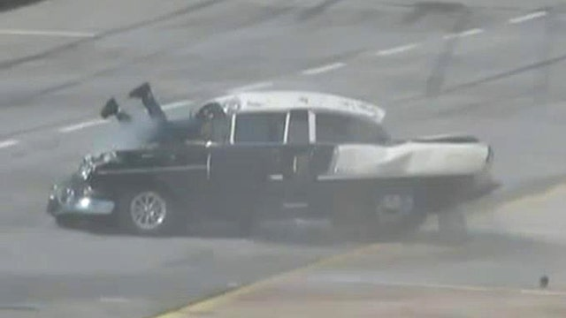 Driver hangs out windshield after dramatic drag race crash