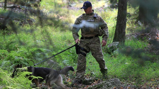 Terrain, bears present challenges in search for cop killer