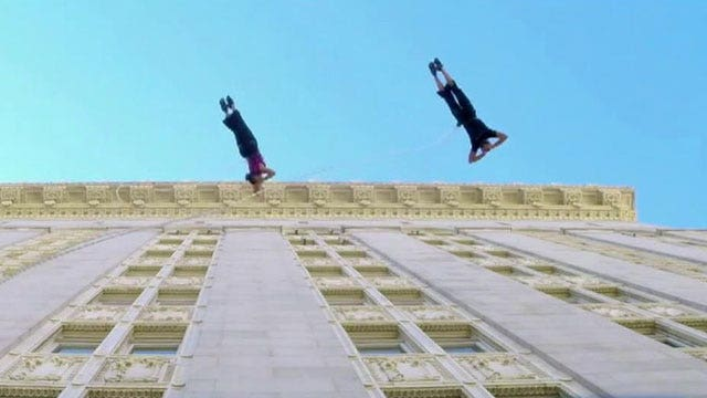 Dancers waltz on walls of Oakland's city hall