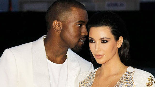 Kim attacked, Kanye booed