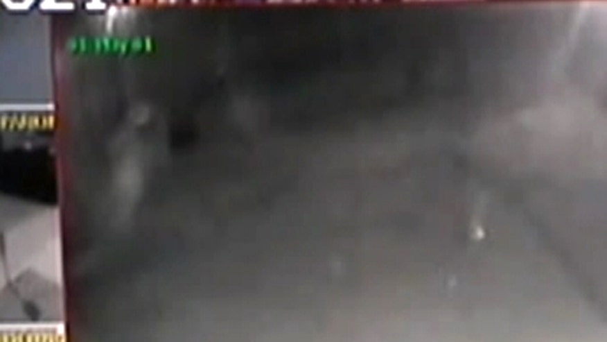 Raw video: New Mexico police say image in surveillance video is a ghost