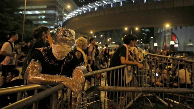 Fallout of unrest in Hong Kong on global economies
