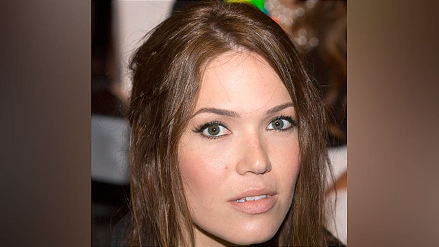Mandy Moore is saying she may shave her head--oh no!  Plus a WNBA kiss and Alec antics.