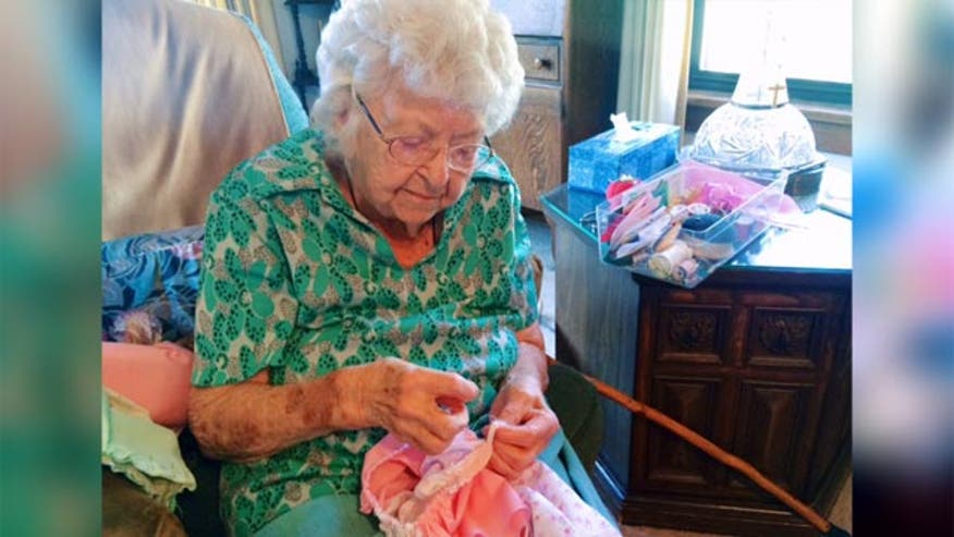A woman working to sew her 1000th dress by her 100th birthday shows Lauren Blanchard how she makes them and who they're for