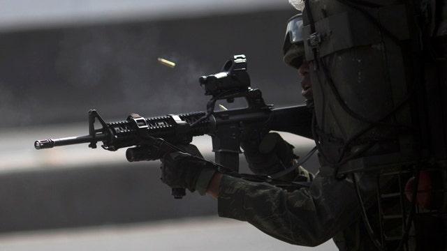 Deadly gun battle between soldiers, gangs on Rio highway