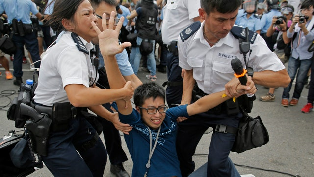 Beijing says Hong Kong protests 'doomed to fail'