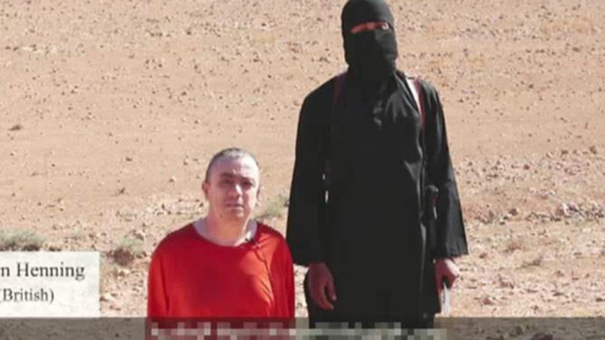 Islamic State group fighter shown beheading Alan Henning, threatening yet another American captive