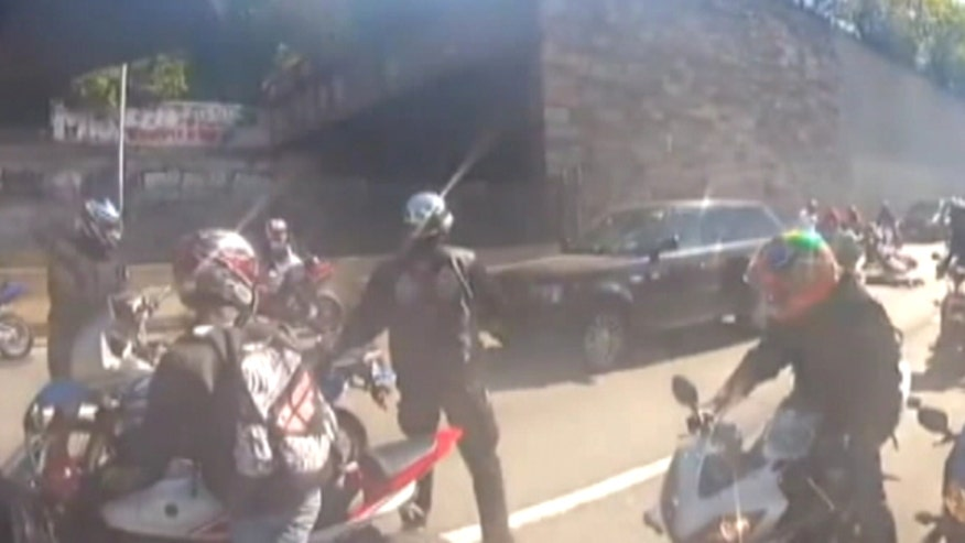 Police: Motorcyclist suspected of beating identified