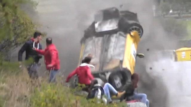 Spectators cheat death as racecar flips, crashes into crowd