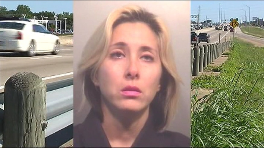 34-year-old Angela Garcia is in a heap of trouble after allegedly putting her 10-year-old son out of the car on the freeway, League City Police say.
