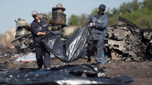 Questions raised by MH17 victim found wearing oxygen mask