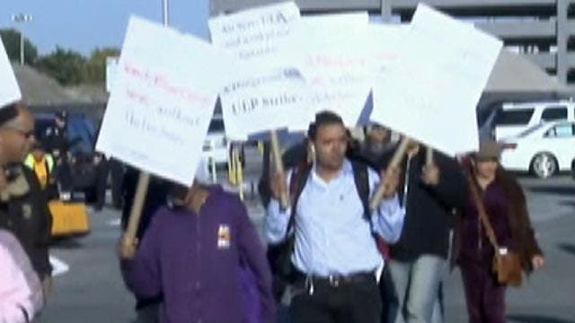 Airport workers striking over Ebola concerns return to work