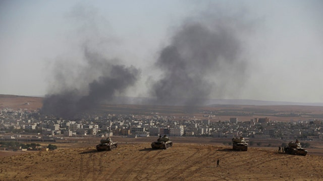 Kurds struggle to defend besieged Syrian town from ISIS