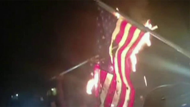 Protesters burn American flags in St. Louis