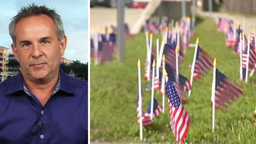 Jeff Verzi receives support after being told to remove American flags