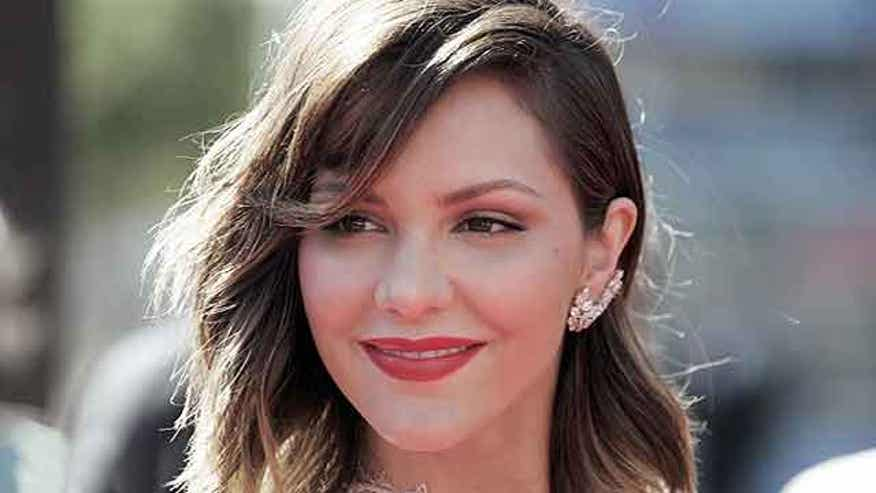Katherine McPhee was spotted kissing her 'Smash' director.