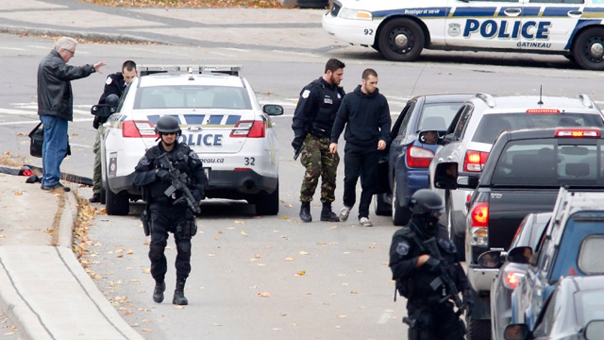 Are shootings in Canadian Parliament complex indicative of terror or a lone wolf? What precautions should US officials take?