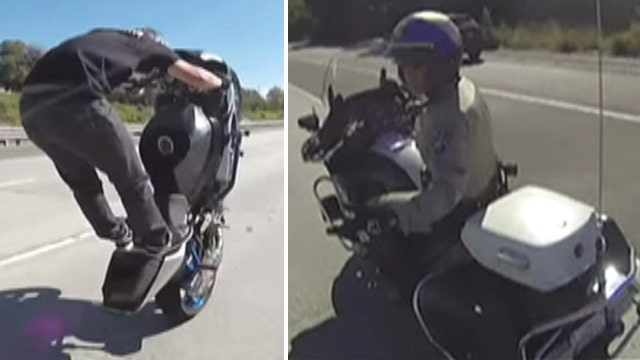 Bully bikers shoo away cop who tries to pull them over