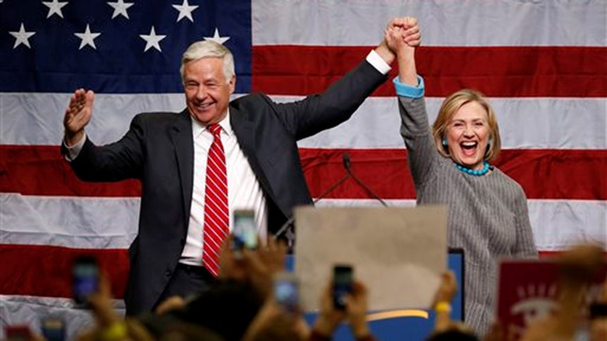 Candidates embrace Clintons ahead of midterms