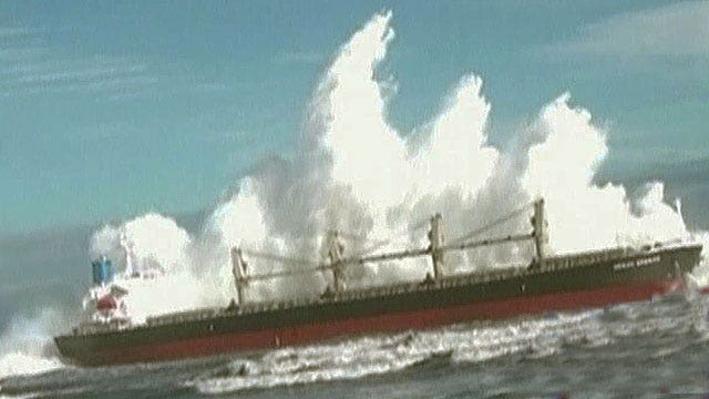 How does the U.S. Navy prepare for monster waves?