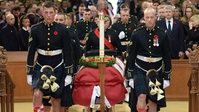 Thousands pay final respects to slain Canadian solider
