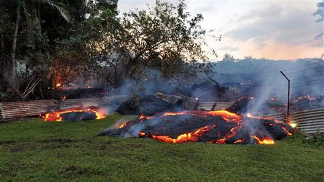 Hawaiian lava flows now threaten homes, businesses