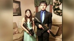 "A Massachusetts teen suspended from school for posting a photograph with her boyfriend while holding replica assault weapons made an ""innocent mistake"" and should not be disciplined, her father said Wednesday."