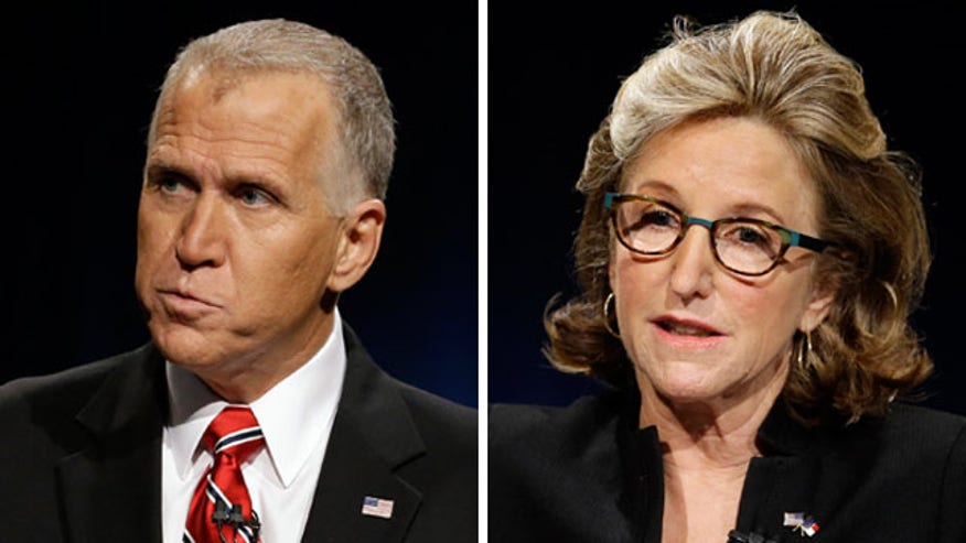 Incumbent Kay Hagan and GOP challenger Thom Tillis  neck and neck in the polls