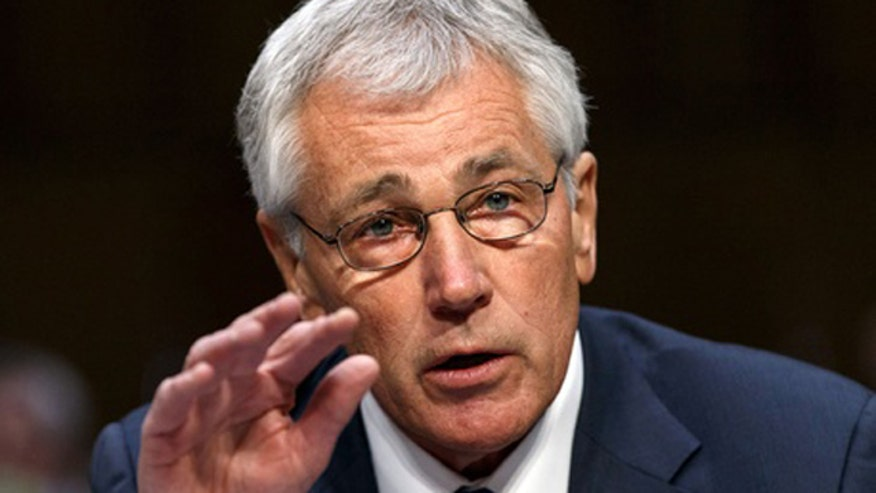 Defense Secretary Hagel signs controlled monitoring regimen order