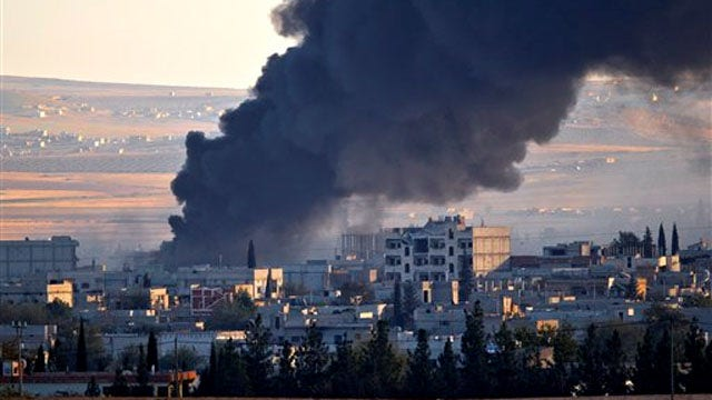 Launches new airstrikes as battle for kobani rages latest news